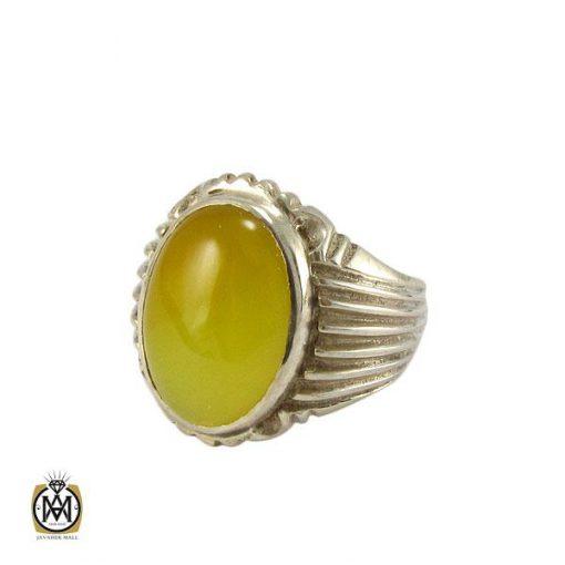 انگشتر عقیق زرد مردانه با حکاکی شرف الشمس – کد ۸۱۴۱