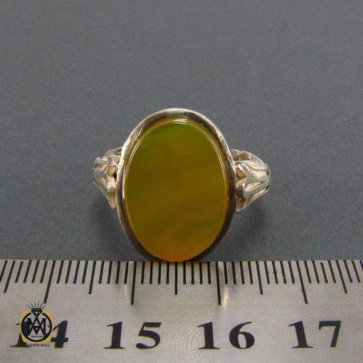 انگشتر عقیق زرد مردانه با حکاکی شرف الشمس – کد ۸۱۴۳