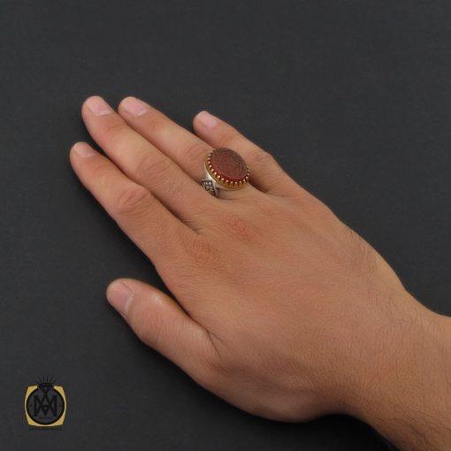 انگشتر عقیق قرمز مردانه با حکاکی ومن یتق الله - کد 8635 - 5 54 510x510