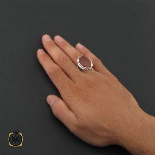 انگشتر عقیق قرمز مردانه با حکاکی ومن یتق الله - کد 8652 - 5 70 510x510
